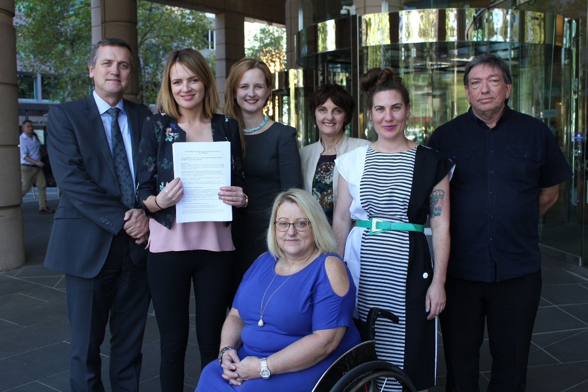 Representatives from six of the disability organisations that signed the joint statement.
